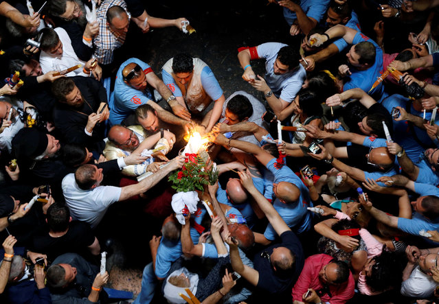 Worshippers light up their candles as they take part in the Christian Orthodox Holy Fire ceremony at the Church of the Holy Sepulchre in Jerusalem's Old City April 30, 2016. (Photo by Ammar Awad/Reuters)