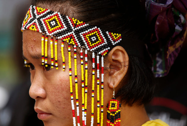 A Manobo indigenous person participates in a rally held by human rights advocates and representatives from Filipino indigenous tribes outside the Armed Forces of the Philippines camp in Quezon City, Philippines, 09 August 2019. The rally marked International Day of the World's Indigenous Peoples. The protesters called for an end to the harassment of indigenous groups by government security forces and an end to the damage done to indigenous lands by private firms. (Photo by Rolex dela Peña/EPA/EFE)