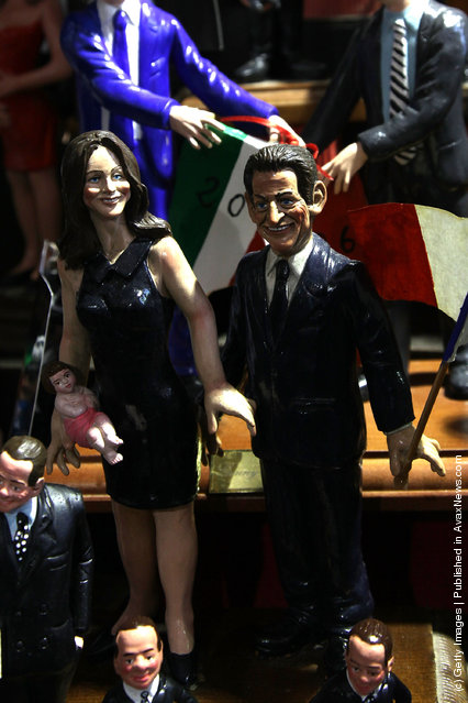 Figurines featuring famous people are shown outside 'Di Virgilio' store at Via San Gregorio Armeno