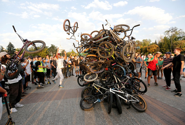 Bicycle riders place their bikes in a heap after a mass ride in Almaty, Kazakhstan August 30, 2019. (Photo by Pavel Mikheyev/Reuters)