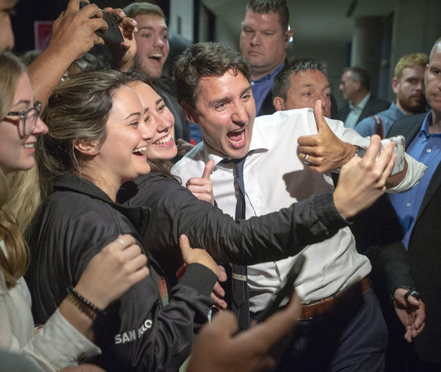Liberal Leader Justin Trudeau takes a photo with supporters at a rally in Thunder Bay, Ontario, on Wednesday, September 25, 2019. (Photo by Ryan Remiorz/The Canadian Press via AP Photo)
