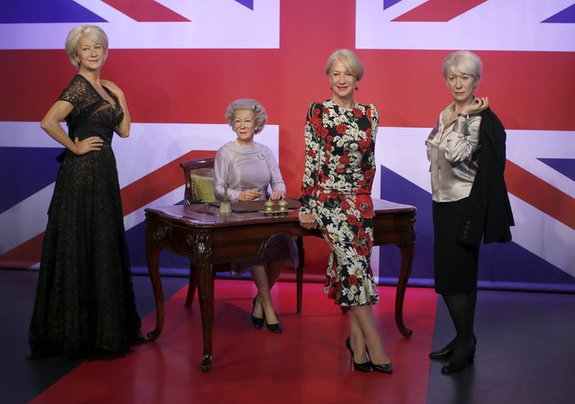 British actor Helen Mirren (2nd R) poses with waxwork models of herself at Madame Tussauds in London, Britain, July 30, 2015. (Photo by Peter Nicholls/Reuters)