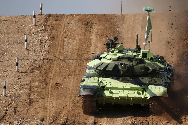 A tank drives on the course of the Tank Biathlon competition during the International Army Games-2015 in Alabino, outside Moscow, Russia, August 4, 2015. (Photo by Maxim Zmeyev/Reuters)
