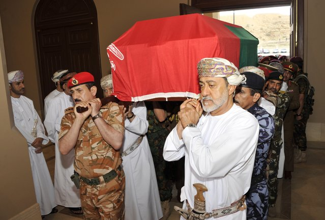 In this photo made available by Oman News Agency, Oman's new sultan Haitham bin Tariq Al Said, right, carries the Sultan Qaboos' coffin at Sultan Qaboos Grand Mosque in Muscat, Oman, Saturday, January 11, 2020. Sultan Qaboos bin Said, the Mideast's longest-ruling monarch who seized power in a 1970 palace coup and pulled his Arabian sultanate into modernity while carefully balancing diplomatic ties between adversaries Iran and the U.S., has died. He was 79. (Photo by Oman News Agency via AP Photo)