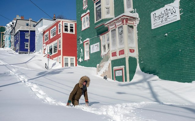 A residents makes their way through the snow in St. John's, Newfoundland on Saturday, January 18, 2020. (Photo by Andrew Vaughan/The Canadian Press via AP Photo)