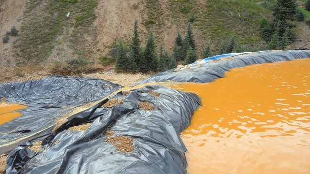 Yellow mine waste water from the Gold King Mine collects in a holding pool in San Juan County, Colorado, is seen in this picture released by the Environmental Protection Agency (EPA) taken August 7, 2015.  A contaminated plume of waste water accidentally released from a Colorado gold mine by U.S. environmental agency workers has spread downstream and reached northern New Mexico, officials said on Saturday. (Photo by Reuters/EPA)