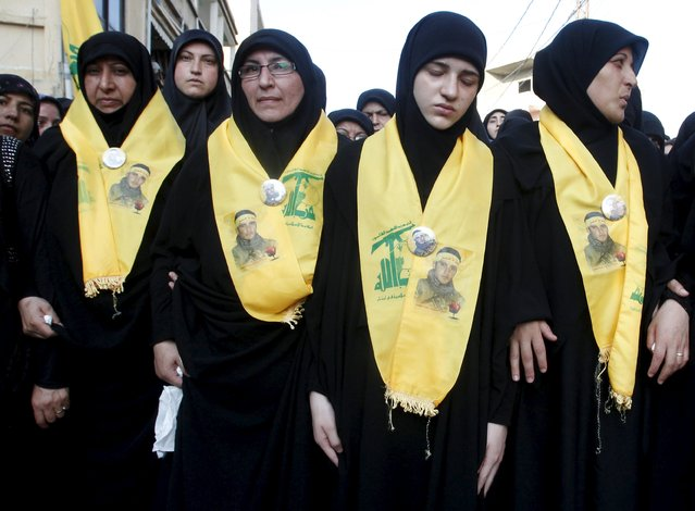 Women mourn during the funeral of Hezbollah fighter Ali Manana, in Sarafand, southern Lebanon August 11, 2015. (Photo by Ali Hashisho/Reuters)