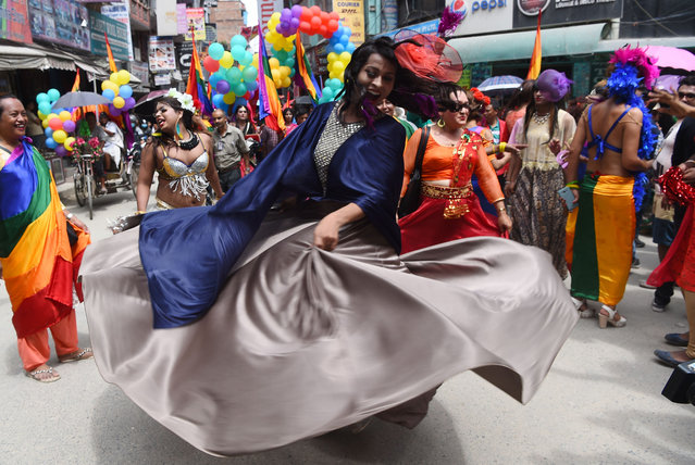 Nepali members of the LGBT community take part in a Gay Pride parade in Kathmandu on August 8, 2017. Scores of gays, lesbians, transvestites and transsexuals from across the country took part in the rally to spread their campaign for sexual rights in the country. In 2013 Nepal introduced citizenships with a third gender option and began issuing passports reflecting the same in 2015. (Photo by Prakash Mathema/AFP Photo)