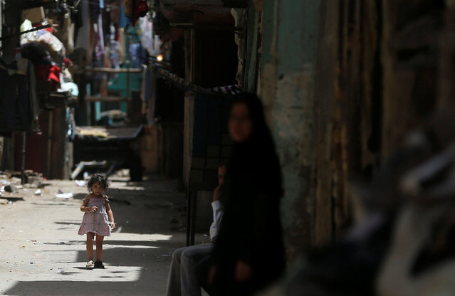 An Egyptian girl walks on a street during the holy month of Ramadan in old Cairo, Egypt June 1, 2016. (Photo by Amr Abdallah Dalsh/Reuters)