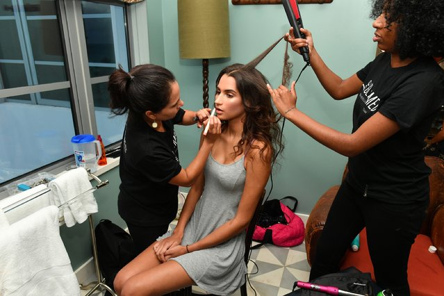 A model gets her hair and makeup done backstage at Dash X Beach Riot Miami at Soho Beach House on July 15, 2016 in Miami Beach, Florida. (Photo by Slaven Vlasic/Getty Images for Beach Riot)