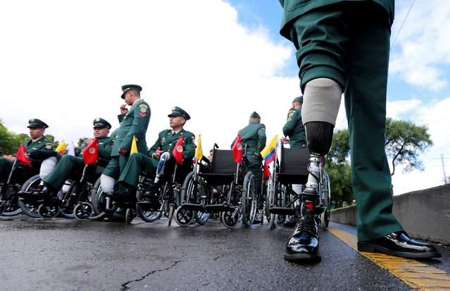 Wounded Colombian Army soldiers wait to march in a military parade to celebrate the 206th anniversary of Colombia's independence in Bogota, Colombia, July 20, 2016. (Photo by John Vizcaino/Reuters)