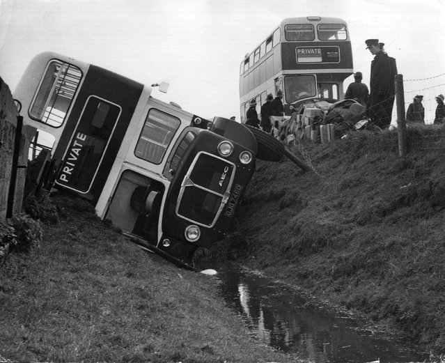 A school bus that overturned and toppled into a ditch near Rye, Sussex. 21st April 1966. (Photo by Keystone)