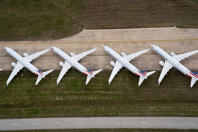 American Airlines 737 max passenger planes are parked on the tarmac at Tulsa International Airport in Tulsa, Oklahoma, U.S. March 23, 2020. (Photo by Nick Oxford/Reuters)
