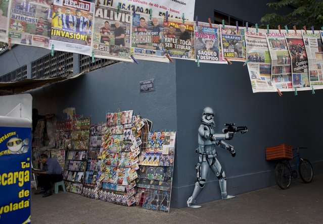 """In this September 1, 2015 photo, a storm trooper mural decorates the exterior of the Michoacan Market in the Condesa neighborhood of Mexico City, by Street Art Chilango cooperative artist Andrik Figueroa Barreto, also known as Andrik Noble. In April 2013, the group's founders launched the hashtag """"#streetartchilango"""" so that anyone using Instagram could plot street art locations on the site's interactive Google map. (Photo by Rebecca Blackwell/AP Photo)"""