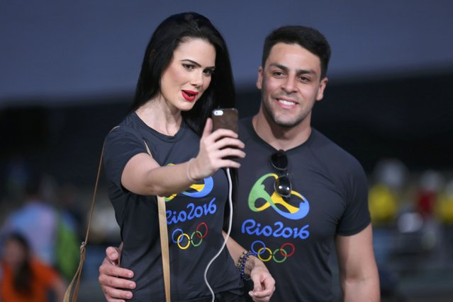 2016 Rio Olympics, Opening ceremony, Maracana, Rio de Janeiro, Brazil on August 5, 2016. A couple takes a selfie before the opening ceremony. (Photo by Mike Blake/Reuters)