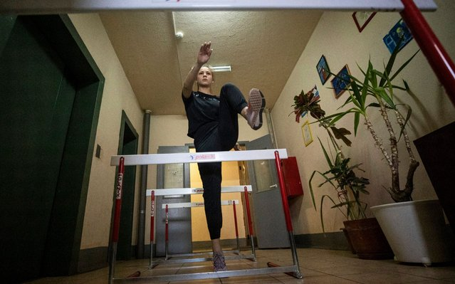 Russian athlete Valeria Nazarova trains in the elevators hall of her apartment house amid the ongoing coronavirus COVID-19 pandemic in Lyubertsy outside Moscow, Russia, 02 May 2020. Many Russian athletes do their training routines and exercises at their improvised gym at home, as Russia is under lockdown to prevent the spread of the SARS-CoV-2 coronavirus which causes the COVID-19 disease. Russian President Vladimir Putin extended a home quarantine across the country to 11 May 2020. (Photo by Sergei Ilnitsky/EPA/EFE/Rex Features/Shutterstock)