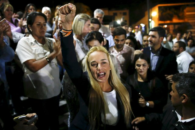 Lilian Tintori (C), wife of jailed opposition leader Leopoldo Lopez, shouts during a news conference in Caracas September 10, 2015. Venezuela's best-known jailed opposition figure, Lopez, was jailed for 13 years on Thursday on charges of inciting 2014 anti-government protests that spiralled into violence killing more than 40 people. (Photo by Carlos Garcia Rawlins/Reuters)