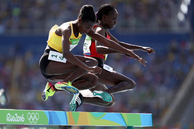 Peruth Chemutai of Uganda and Lydia Chebet Rotich of Kenya competes in round one of the Women's 3000m Steeplechase on Day 8 of the Rio 2016 Olympic Games at the Olympic Stadium on August 13, 2016 in Rio de Janeiro, Brazil. (Photo by Paul Gilham/Getty Images)