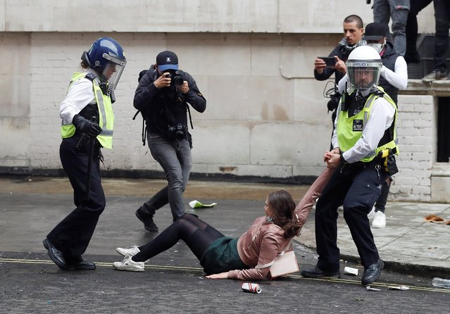 A demonstrator is detained by a Police officer during a Black Lives Matter protest in London, following the death of George Floyd who died in police custody in Minneapolis, London, Britain, June 7, 2020. (Photo by Peter Nicholls/Reuters)