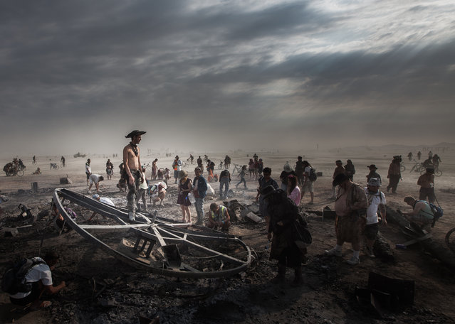 """""""After the Burn"""". The morning after the burn of the main central sculpture (the man) at Burning Man. Inside the base there was a small meteor fragment that whoever found could keep this is the scavenger hunt. Photo location: Near Gerlach, Nevada, USA. (Photo and caption by Umar Brewer/National Geographic Photo Contest)"""
