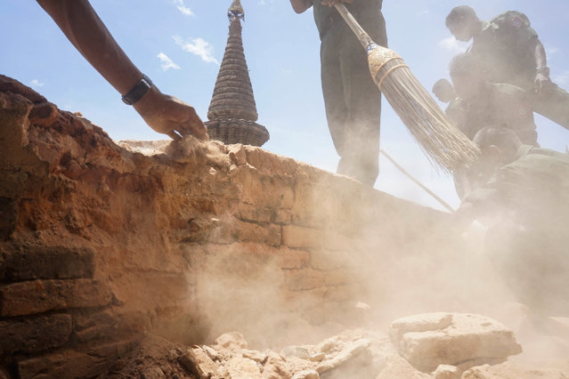 Myanmar Military personnel examine the Htilominlo Pagoda in Bagan, Myanmar, Thursday, August 25, 2016.  Using brooms and their hands, soldiers and residents of the ancient Myanmar city famous for its historic Buddhist pagodas began cleaning up the debris Thursday from a powerful earthquake that shook the region and damaged nearly 200 temples. (Photo by Hkun Lat/AP Photo)