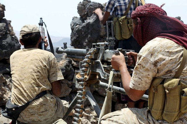 Soldiers loyal to the Yemeni government take positions during fighting with Houthi militiamen in the Yemeni frontline province of Marib September 16, 2015. (Photo by Reuters/Stringer)