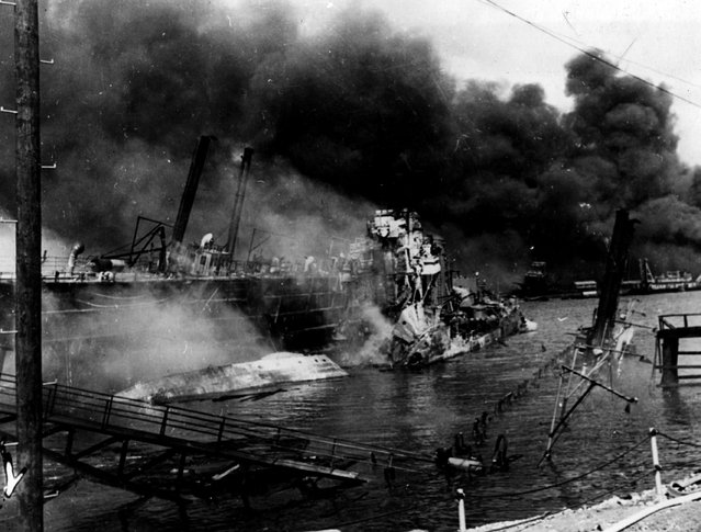 December 1941:  The horror of destruction at the US Naval Base of Pearl Harbour (Pearl Harbor) which was attacked by the Japanese airforce on the 7th December 1941. The destroyer 'Shaw' is a tangled mess of wreckage but she was back in use one year later.  (Photo by Fox Photos/Getty Images)