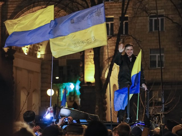Ukrainian opposition figure and Georgian former President Mikheil Saakashvili waves to supporters after he was released from detention in Kiev, Ukraine December 11, 2017. (Photo by Gleb Garanich/Reuters)