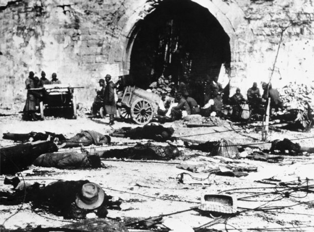 The dead litter the streets in Nanking, China, following the Japanese raid on this city, leaving it in utter devastation, December 14, 1937. (Photo by AP Photo)