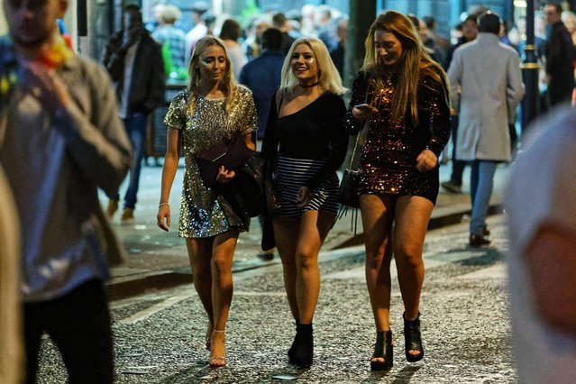 Revellers hit the town in Swansea, Wales, England to celebrate the start of 2018 on December 31, 2017. (Photo by Athena Picture Agency)