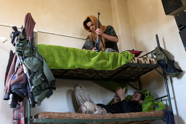 Rebel fighters rest on a double bed in Jubata al-Khashab, in Quneitra countryside, Syria September 11, 2016. (Photo by Alaa Al-Faqir/Reuters)