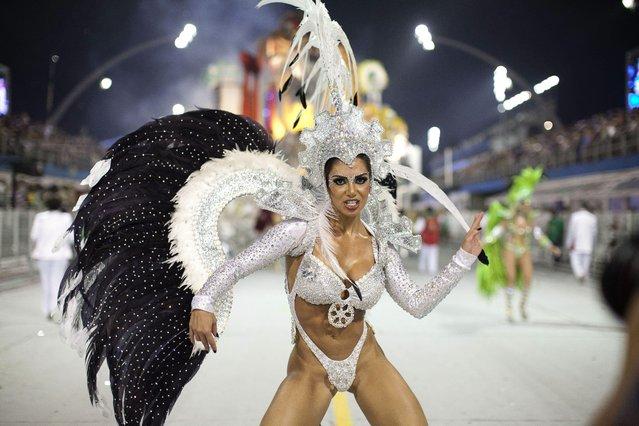 "A member of the samba school X-9 Paulistana special group takes part in a carnival parade at the ""sambodromo"" of Anhembi in Sao Paulo, Brazil, early 09 February 2013. (Photo by Sebastiao Moreira/EPA)"