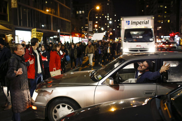 A driver argues with protesters in New York, November 25, 2014. (Photo by Eduardo Munoz/Reuters)