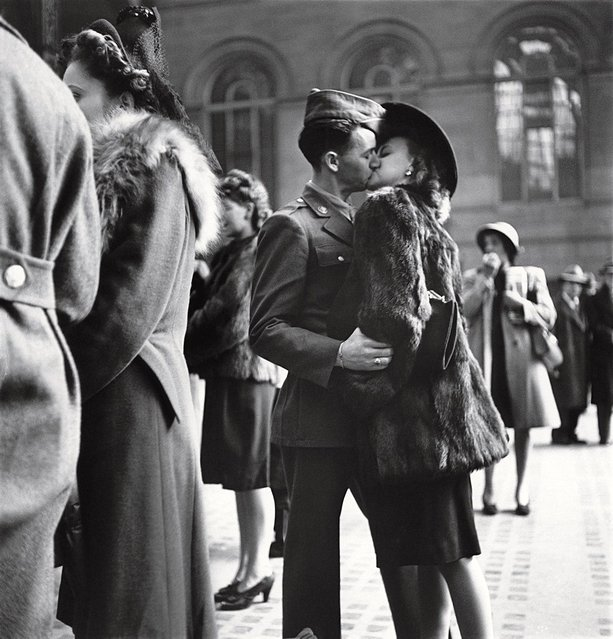 Couple in Penn Station sharing farewell kiss before he ships off to war during WWII. (Photo by Alfred Eisenstaedt/Time & Life Pictures)