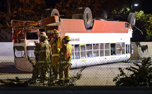 Emergency crews work on the scene following a fatal accident involving a car and a Lehigh University bus on Tuesday, October 27, 2015, in Bethlehem, Pa. (Photo by Emily Paine/The Morning Call via AP Photo)