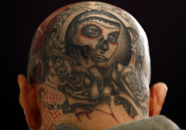 The tatooed head of a man is pictured during the Warsaw Tattoo Convention 2014 in Warsaw November 29, 2014. (Photo by Kacper Pempel/Reuters)
