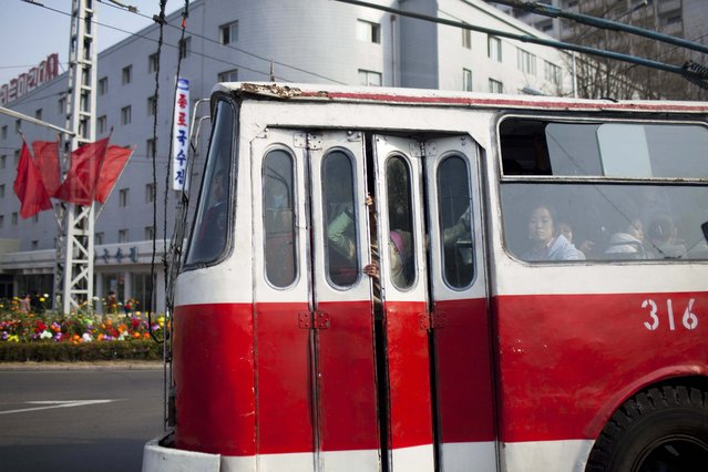 In this April 15, 2011 photo, a city tram carries passengers in Pyongyang, North Korea. (Photo by David Guttenfelder/AP Photo)