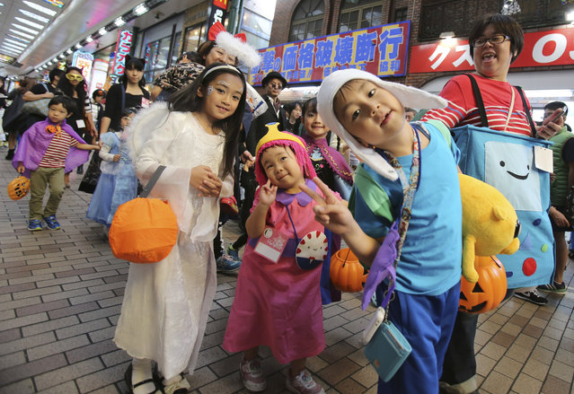 In this October 24, 2015 photo, participants parade during an annual Halloween event in Kawasaki, near Tokyo. Although Japan has its own traditional festivals to celebrate spookiness and honor the dead, Halloween is being observed with a special frenzy. (Photo by Koji Sasahara/AP Photo)