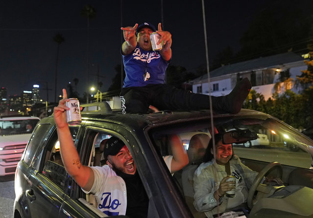 Los Angeles Dodgers fans celebrate on Sunset Blvd. after watching the broadcast of Game 6 of the baseball World Series in Los Angeles on Tuesday, October 27, 2020. The Los Angeles Dodgers defeated the Tampa Bay Rays 3-1 and won the World Series. (Photo by Damian Dovarganes/AP Photo)