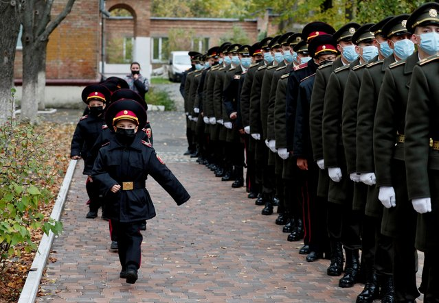 Young military march for a ceremony of receiving their shoulder marks in Kyiv, Ukraine on November 6, 2020. (Photo by Gleb Garanich/Reuters)