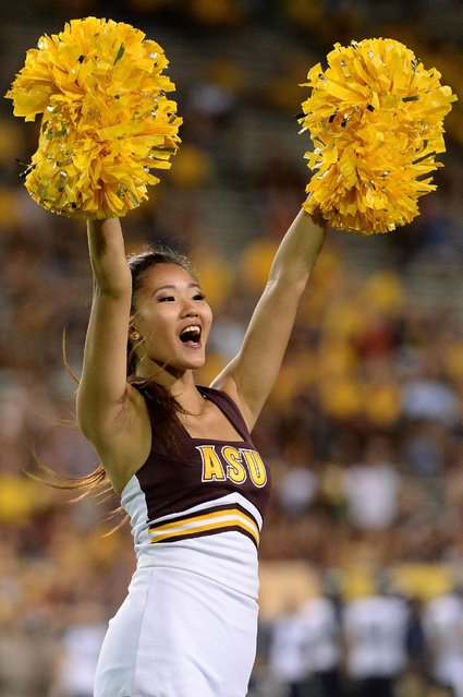 Arizona State Sun Devils cheerleader performs during the game against the Northern Arizona Lumberjacks at Sun Devil Stadium on September 3, 2016 in Tempe, Arizona. The Arizona State Sun Devils won 44-13. (Photo by Jennifer Stewart/Getty Images)