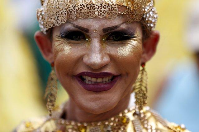A reveller poses for a photo during the LGBT Pride Parade in Copacabana beach in Rio de Janeiro, Brazil, November 15, 2015. REUTERS/Pilar Olivares
