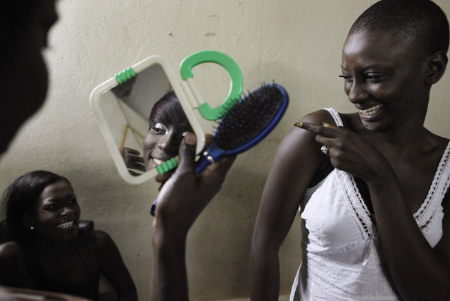 Models joke around backstage during Dakar Fashion Week July 15, 2010. Picture taken July 15, 2010. (Photo by Finbarr O'Reilly/Reuters)