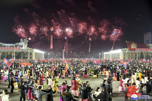 In this photo provided by the North Korean government, people dance in the celebration for the ruling party congress, at Kim Il Sung Square in Pyongyang, North Korea Thursday, January 14, 2021. (Photo by Korean Central News Agency/Korea News Service via AP Photo)