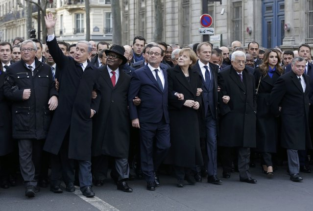 French President Francois Hollande is surrounded by head of states including (L to R) European Commission President European Commission President Jean-Claude Juncker, Israel's Prime Minister Benjamin Netanyahu. (Photo by Philippe Wojazer/Reuters)