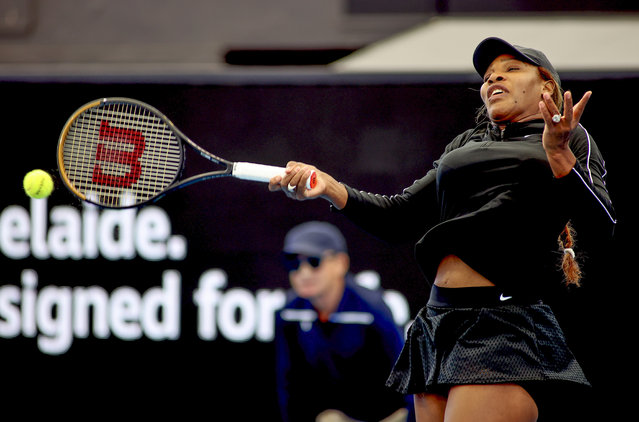 United States' Serena Williams plays a forehand return to Japan's Naomi Osaka during an exhibition tennis event in Adelaide, Australia, Friday, January 29. 2021. (Photo by Kelly Barnes/AAP Image via AP Photo)