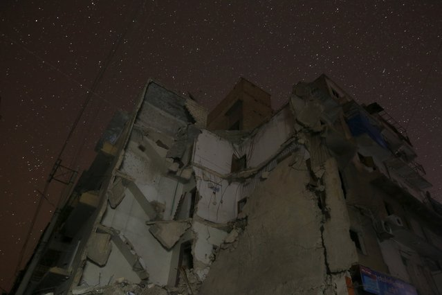 Damaged buildings are pictured at night in Aleppo, Syria December 11, 2015. (Photo by Ammar Abdullah/Reuters)