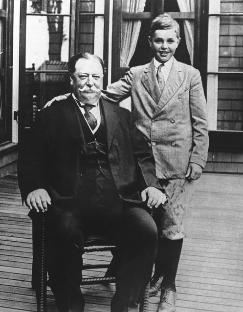 """A picture of the former Chief Justice Taft, with his son Charles taken when Taft was President. Photo shows them at the """"summer White House"""" at Beverly, Massachusetts on February 3, 1930. (Photo by AP Photo)"""