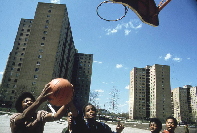 Youths play basketball at Stateway Gardens highrise housing project on the South Side, May 1973. (Photo by John H. White/NARA via The Atlantic)