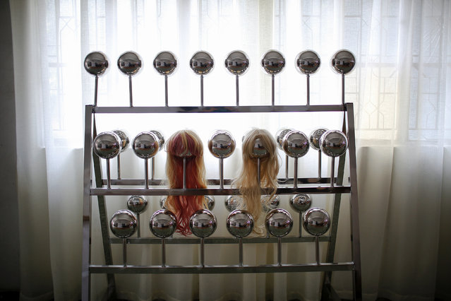 Wigs displayed on a shelf at the WMDOLL factory in Zhongshan, Guangdong Province, China, July 11, 2018. (Photo by Aly Song/Reuters)